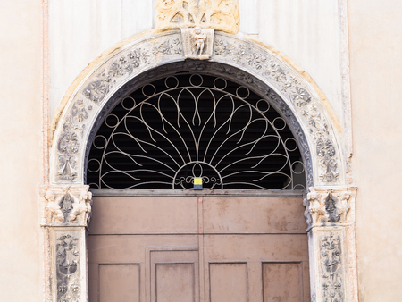 travel to Italy - door of medieval palazzo on street contra porti in Vicenza city in spring. Stock Photo