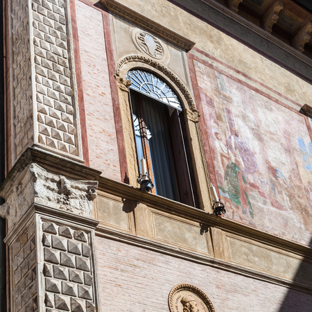 contra: travel to Italy - wall with fresco on medieval palazzo thiene on street contra porti in Vicenza city in spring. Stock Photo