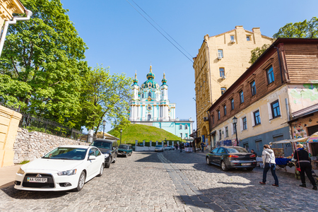 KIEV, UKRAINE - MAY 5, 2017: people on Andriyivskyy Descent and view of St Andrews Church in Kiev city in spring. The church was constructed in 1747-1754 by architect Bartolomeo Rastrelli Editorial