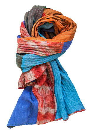 knotted stitched patchwork scarf from batik and painted silk fabric pieces isolated on white background