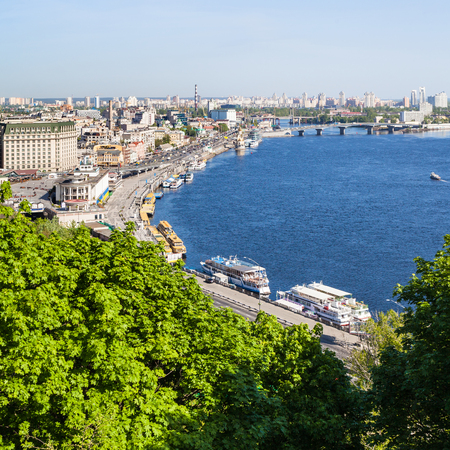 travel to Ukraine - view of Kiev city Podil District with River Port and Dnieper River from Volodymyrska Hill (Saint Volodymyr Hill) in spring