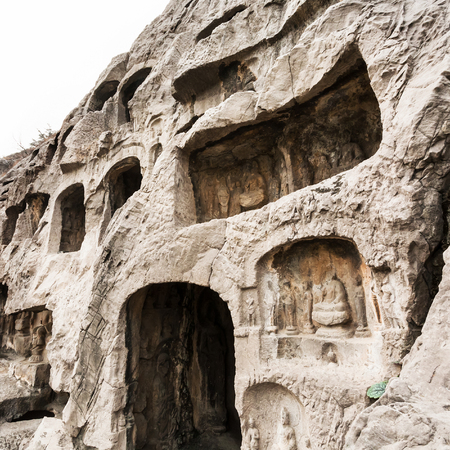 LUOYANG, CHINA - MARCH 20, 2017: carved wall of caves in West Hill of Chinese Buddhist monument Longmen Grottoes. The complex was inscribed upon the UNESCO World Heritage List in 2000 Editorial