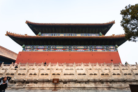 BEIJING, CHINA - MARCH 19, 2017: people near wall of Imperial Ancestral Temple (Taimiao, Working Peoples Cultural Palace) in Beijing Imperial city in spring. The first Hall was built in 1420