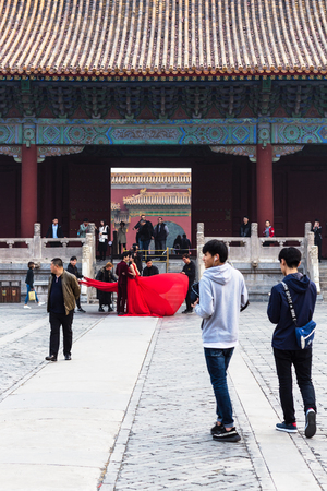 BEIJING, CHINA - MARCH 19, 2017: tourists on courtyard of Imperial Ancestral Temple (Taimiao, Working Peoples Cultural Palace) in Beijing Imperial city in spring. The first Hall was built in 1420 Editorial