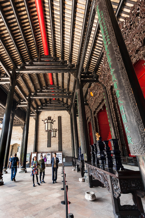 GUANGZHOU, CHINA - APRIL 1, 2017: tourists in patio of Chen Clan Ancestral Hall academic temple (Guangdong Folk Art Museum) in Guangzhou. The house was prepared for the imperial examinations in 1894