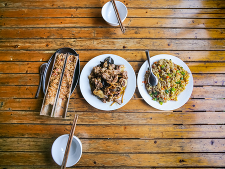 travel to China - top view of served local chinese dinner in rustic eatery in area Dazhai Longsheng Rice Terraces (Dragons Backbone terrace, Longji Rice Terraces) country in spring Stock Photo