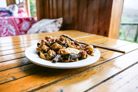 travel to China - plate with chicken and mushrooms in rustic eatery in area Dazhai Longsheng Rice Terraces (Dragons Backbone terrace, Longji Rice Terraces) country in spring