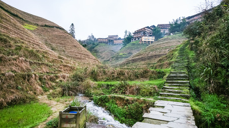 travel to China - way to Tiantouzhai village between terraced hills in area of Dazhai Longsheng Rice Terraces (Dragons Backbone terrace, Longji Rice Terraces) in spring season Stock Photo