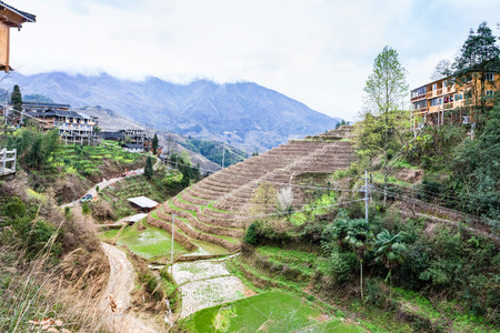 travel to China - view of Dazhai village in area Longsheng Rice Terraces (Dragons Backbone terrace, Longji Rice Terraces) country in spring day
