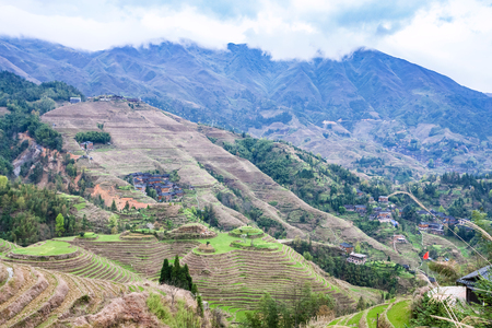 travel to China - view of terraced slope in Dazhai country from viewpoint Seven Stars Chase The Moon in area Longsheng Rice Terraces (Longji Rice Terraces) in spring