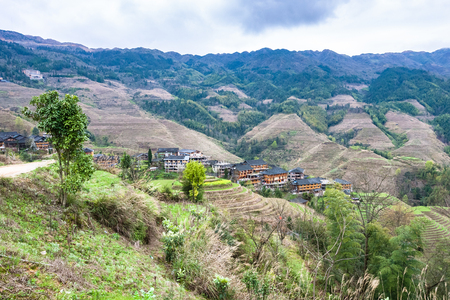 travel to China - view of Dazhai country with village from viewpoint Seven Stars Chase The Moon in area Longsheng Rice Terraces (Longji Rice Terraces) in spring Stock Photo