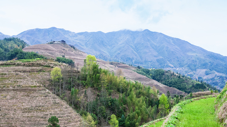 travel to China - view of hills near Dazhai village in country of Longsheng Rice Terraces (Dragons Backbone terrace, Longji Rice Terraces) in spring Stock Photo