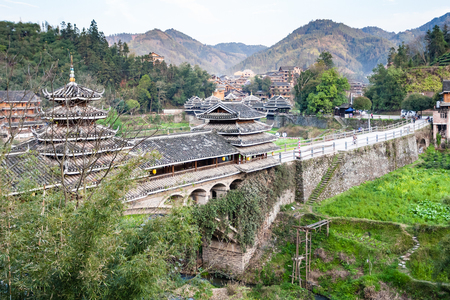 CHENGYANG, CHINA - MARCH 26, 2017: view of Chengyang Wind and Rain Bridge in Sanjiang Country in spring. In Chengyang there are eight villages and several Fengyu Bridges of the Dong people