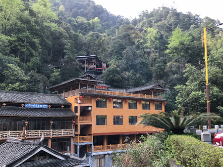 JIANGDI, CHINA - MARCH 26, 2017: bridge and resort hotel in green hills in Guilin Longsheng Hot Springs National Forest Park of Xiangshan District in spring season