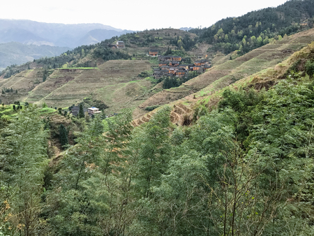 travel to China - view of overgrown mountains of Dazhai country in area Longsheng Rice Terraces (Longji Rice Terraces, Dragons Backbone terrace) in spring