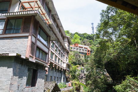 travel to China - facades of apartment houses in Jiangdi village in Longsheng Hot Springs National Forest Park of Xiangshan District in spring season