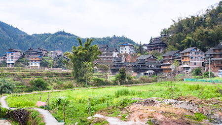 travel to China - view of Chengyang village with Bridge from backyards in area of Sanjiang Dong Autonomous County in spring morning