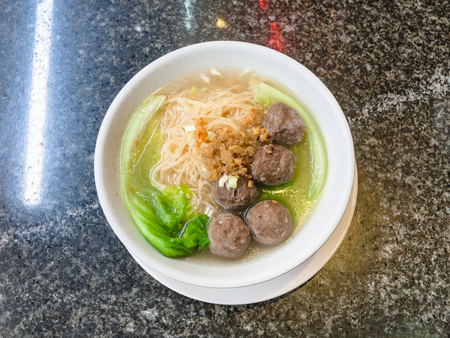 travel to China - top view of meatballs with noodle soup in bowl on table in chinese cafe in Yangshuo town County