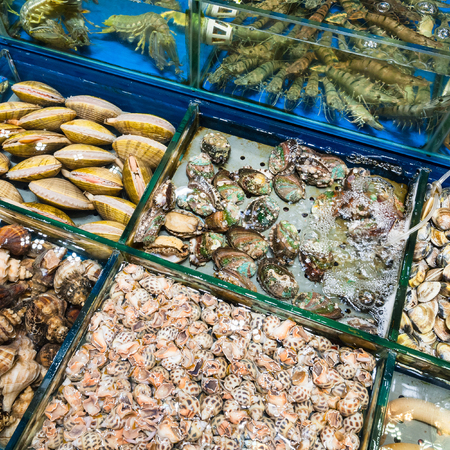 Travel to China - various clams and prawns on Huangsha Aquatic Product Trading Market in Guangzhou city in spring season