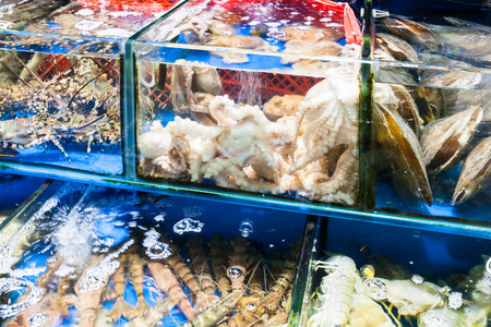 Travel to China - octopus, calms, prawns on Huangsha Aquatic Product Trading Market in Guangzhou city in spring season Stock Photo