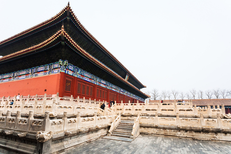 BEIJING, CHINA - MARCH 19, 2017: people near Imperial Ancestral Temple (Taimiao, Working Peoples Cultural Palace) in Beijing Imperial city in spring. The first Hall was built in 1420
