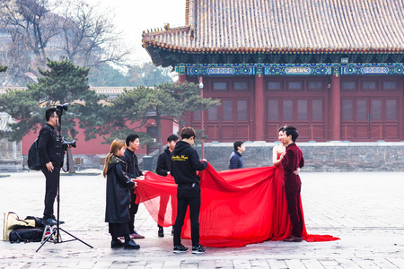 BEIJING, CHINA - MARCH 19, 2017: people in photosession on courtyard of Imperial Ancestral Temple (Taimiao, Working Peoples Cultural Palace) in Beijing Imperial city in spring Editorial