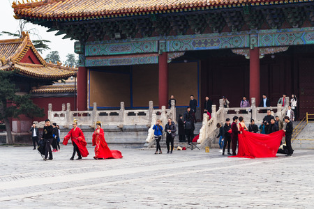 BEIJING, CHINA - MARCH 19, 2017: visitors on courtyard of Imperial Ancestral Temple (Taimiao, Working Peoples Cultural Palace) in Beijing Imperial city in spring. The first Hall was built in 1420