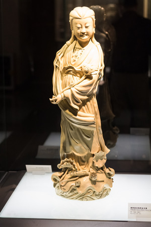 GUANGZHOU, CHINA - MARCH 31, 2017: porcelain figure in Chen Clan Ancestral Hall (Guangdong Folk Art Museum) in Guangzhou city. The house was prepared for imperial examinations in 1894 Editorial