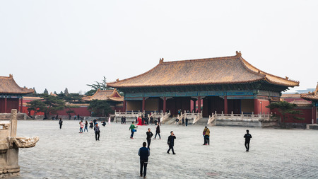 BEIJING, CHINA - MARCH 19, 2017: people walk at courtyard of Imperial Ancestral Temple (Taimiao, Working Peoples Cultural Palace) in Beijing Imperial city in spring. The first Hall was built in 1420