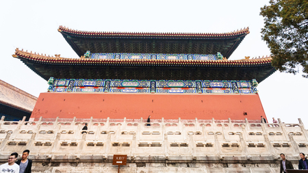 BEIJING, CHINA - MARCH 19, 2017: tourists near wall of Imperial Ancestral Temple (Taimiao, Working Peoples Cultural Palace) in Beijing Imperial city in spring. The first Hall was built in 1420