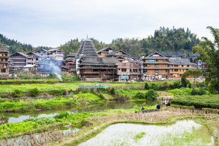 CHENGYANG, CHINA - MARCH 27, 2017: people on gardens in Chengyang village of Sanjiang Dong Autonomous County in spring. Chengyang includes eight villages of the Dong people Editorial
