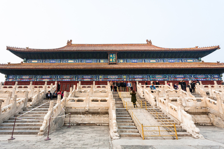 BEIJING, CHINA - MARCH 19, 2017: tourists near facade of Imperial Ancestral Temple (Taimiao, Working Peoples Cultural Palace) in Beijing Imperial city in spring. The first Hall was built in 1420