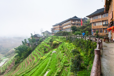 TIANTOUZHAI, CHINA - MARCH 23, 2017: view of terraced hills in Tiantouzhai village of Dazhai Longsheng country in spring. This is village in famous scenic area of Longji Rice Terraces in China