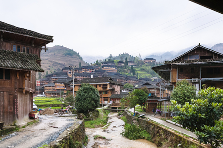 DAZHAI, CHINA - MARCH 23, 2017: view of Dazhai Longsheng village in spring. This is central village in famous scenic area of Longji Rice Terraces in China