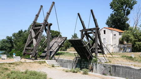 ARLES, FRANCE - JULY 7, 2008: tourists near Pont Van Gogh, replica of the Langlois Bridge, drawbridge which was the subject of several paintings by Vincent van Gogh in 1888, on Canal dArles a Fos