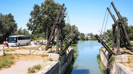 ARLES, FRANCE - JULY 7, 2008: visitors near Pont Van Gogh, replica of the Langlois Bridge, drawbridge which was the subject of several paintings by Vincent van Gogh in 1888, on Canal dArles a Fos