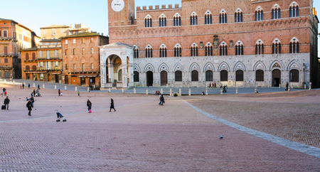 SIENA, ITALY - JANUARY 11, 2009: people Piazza del Campo (Campo square) in Siena city in winter.