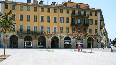 maritimes: NICE, FRANCE - JULY 11, 2008: People on square Place Garibaldi in Nice city. Nice is located in French Riviera , it is the capital of Alpes-Maritimes departement located in the French Riviera