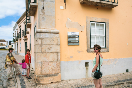 FARO, PORTUGAL - JUNE 25, 2006: tourists in historical center of Faro city. Faro is capital of the district of the same name, in the Algarve region of southern Portugal