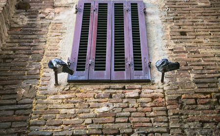 jalousie: travel to Italy - pigeons near closed window of medieval house in Siena city in winter