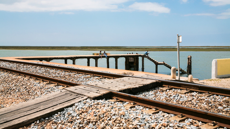 formosa: Travel to Algarve Portugal - Railway platform near nature park of Ria Formasa in Faro city