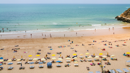 Travel to Algarve Portugal - above view of people on urban beach Praia do Peneco in Albufeira city Stok Fotoğraf