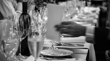 formal dinner party: served table at the beginning of an official dinner in restaurant Stock Photo