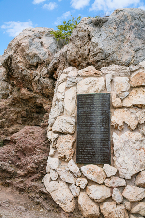 travel to Greece - Bronze plaque of Apostle Pauls Great sermon Speech (in Greek) on the path to the Areopagus (Mars Hill) in Athens. Stock Photo