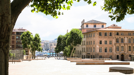Travel to Provence, France - view of old port through Rue de la Mairie in Marseilles city