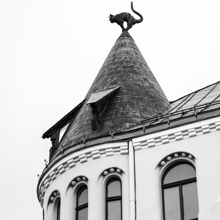 travel to Latvia - cat figure on turret rooftop of Cat House in Riga city in autumn. Palace was built in 1909, designed by architect Friedrich Scheffel Stock Photo