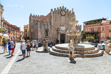 TAORMINA, ITALY - JUNE 29, 2017: people on Piazza dell Duomo near fountain in Taormina city. Taormina is resort town on Ionian Sea in Sicily Editorial