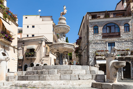 TAORMINA, ITALY - JUNE 29, 2017: baroque style fountain (Quattro Fontane di Taormina) on Piazza Del Duomo in summer day. Taormina is resort town on Ionian Sea in Sicily