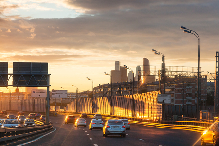 gloaming: MOSCOW, RUSSIA - JULY 3, 2017: car traffic on Luzhnetskaya overpass of Third Ring Road on summer sunset. The Third Ring it is one of Moscows main roads, it is 35 km in length, about 10 km in diameter