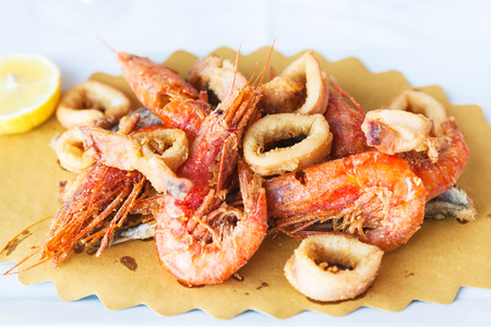 typical italian food - plate with fried local seafood in sicilian restaurant Stock Photo
